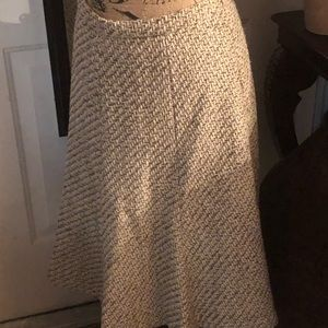 Tan woven flare skirt gold threads interwoven